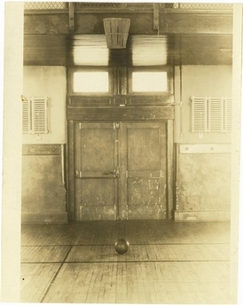 "Original 1891 ""Basket Ball"" court at Springfield College. Note the peach basket attached to the wall"