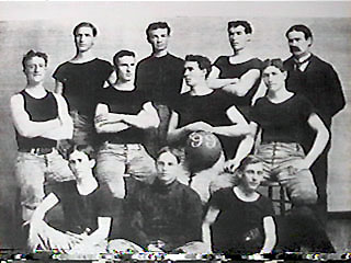 The 1899 University of Kansas basketball team, with Dr. James Naismith at the back, right.