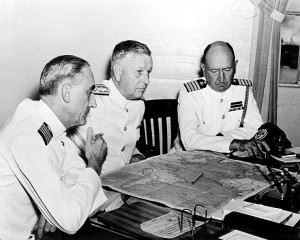 Admiral Husband E. Kimmel, Commander in Chief of the U.S. Pacific Fleet (center), reviews his war plans with two senior members of at Pearl Harbor, Hawaii Territory, sometime before December 7, 1941. (U.S. Naval Historical Center).