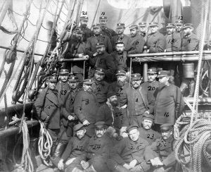 Survivors with their U.S. Navy rescuers photographed on board USS Thetis -(as numbered on the original print) Number 22 - First Lieutenant Adolphus W. Greely