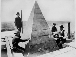 Workers set the capstone on top of the Washington Monument, Dec. 6, 1884. Engineer Gen. Thomas L. Casey, in derby hat, oversees the work. (AP Photo)