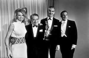 Academy Awards (left to right) Angie Dickinson, Alfred Newman, Ken Darby, Gene Kelly