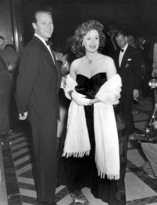 Susan Hayward accompanied by her husband, Jess Barker, arrives at the Academy Awards ceremony. March 1950