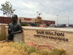 A statue of Sam Walton and his dog outside of Wal-Mart in his birthplace of Kingfisher, Oklahoma.