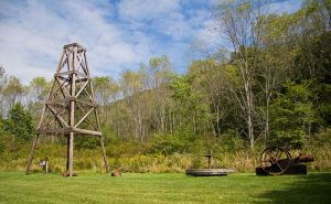 A historic recreation of a wooden oil derrick at Oil Creek State Park