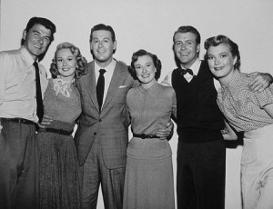 """""""Shes Working Her Way Through College"""" (left to right) Ronald Reagan, Virginia Mayo, Don DeFore, Phyllis Thaxter, Gene Nelson Patrice Wymore."""