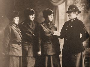 A well known photo of Opha Mae Johnson inspecting 3 female Marines, taken in 1918.