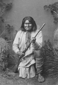 Geronimo; kneeling with rifle, 1887