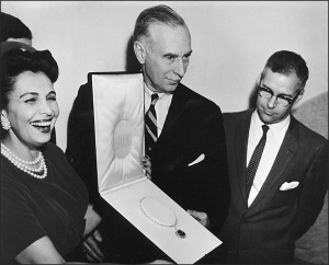 Photo from the formal presentation of the Hope Diamond to the Smithsonian on September 10th, 1958. From left to right: Mrs. Harry Winston, wife of the donor; Leonard Carmichael, Secretary of the Smithsonian; Dr. George S. Switzer, Curator of Mineralogy.