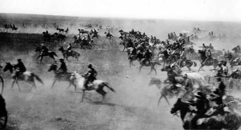 Horses rush forward during the 1893 Cherokee Strip Land Run.