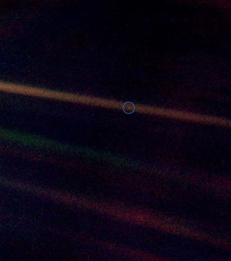 Seen from about 3.7 billion miles away, Earth appears as a Pale Blue Dot within the darkness of deep space. Photo taken by Voyager 1 in 1990.