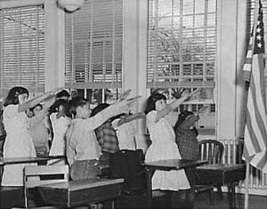 Children performing the Bellamy salute to the flag of the United States.