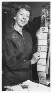 Evelyn displays her aircraft certification cards in this 1960 photo from the News Sentinel archives.