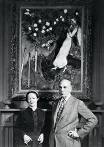 Founders-Lila-and-DeWitt-Wallace-in-front-of-Marc-Chagall's--Three-Candles,--one-of-the-many-paintings-that-graced-company-hallways