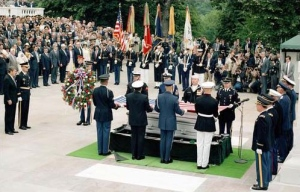 The presidential wreath was brought forward toward President Reagan during the interment ceremony for the Unknown Serviceman of the Vietnam Era at the Tomb of the Unknowns on May 28, 1984.