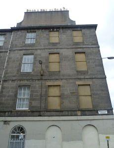 Blocked-up windows on Brighton Street in Edinburgh
