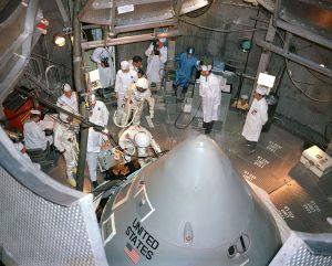 The Apollo 1 crewmen enter their spacecraft in the altitude chamber at Kennedy Space Center, October 18, 1966