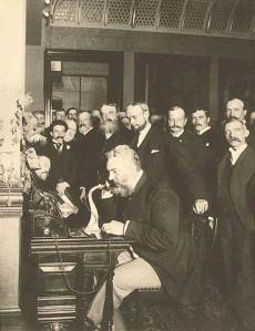 Alexander Graham Bell making a long distance telephone call in 1882