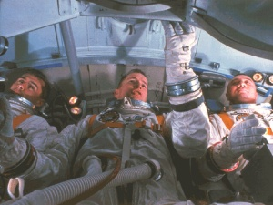 Roger Chaffee, Edward White, and Gus Grissom training in a simulator of their Command Module cabin, January 19, 1967