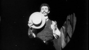 Frame from Dickson Greeting, the first American film shown to a public audience in 1891.