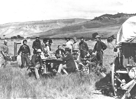 "Wyoming. Group of all the members of the Hayden Geological Survey of 1870, taken by William Henry Jackson on August 24, 1870 while in camp at Red Buttes at the junction of the North Platte and Sweetwater Rivers. Ferdinand Hayden sits at the far end of the table in a dark jacket and no hat. Standing left to right: John ""Potato John"" Raymond and ""Val,"" cooks; Sanford R. Gifford, landscape painter; Henry W. Elliott, artist; James Stevenson, assistant; H.D. Schmidt, naturalist; E. Campbell Carrington, zoologist; L.A. Bartlett, general assistant; William Henry Jackson, photographer. Sitting left to right: C.S. Turnbull, secretary; J.H. Beaman, meteorologist; Ferdinand V. Hayden, geologist in charge; Cyrus Thomas, agriculturist; Raphael, hunter; A.L. Ford, mineralogist. 1870. U.S. Geological and Geographical Survey of the Territories (Hayden Survey Photo by William Henry Jackson, standing at far right)"