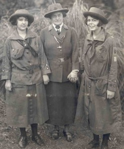 "Juliette ""Daisy"" Gordon Low (center) standing with two Girl Scouts, Robertine McClendon (left) and Helen Ross (right)."