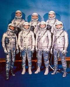 This was the only time the Mercury Seven would appear together in pressure suits. Notice Slayton and Glenn are wearing spray-painted work boots.