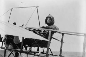 Harriet Quimby aboard the Moisant monoplane she learned to fly in.