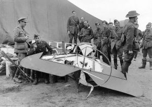 Australian airmen with the Red Baron Richthofen's triplane, after it was dismembered by souvenir hunters.