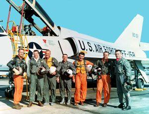The Original Mercury Seven astronauts with a U.S. Air Force F-106B jet aircraft. From left to right: M. Scott Carpenter, Leroy Gordon Cooper, John H. Glenn, Jr., Virgil I. Gus Grissom, Jr., Walter M. Wally Schirra, Jr., Alan B. Shepard, Jr., Donald K. Deke Slayton.