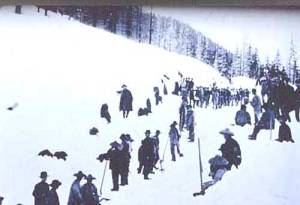 Chinese immigrant railroad workers building the transcontinental railroad in snow